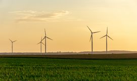 Free Wind Turbines Or Windmills At A Field - Sunset Scene Stock Images - 121521704