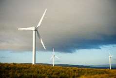 Wind turbines over the blue clouded sky Royalty Free Stock Photography