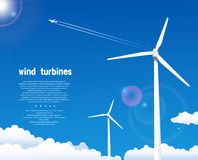 Wind turbines over blue sky Royalty Free Stock Image