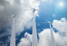 Wind Turbines over clouds Royalty Free Stock Photo