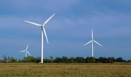 Wind turbines over farmland Stock Photo