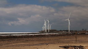 Wind Turbines Over A Frozen Lake. Time-Lapse. stock footage