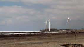 Wind Turbines Over A Frozen Lake. stock video