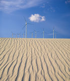 Wind turbines over sand dunes Royalty Free Stock Photos