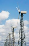 Wind turbines over sky Stock Photo