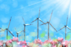 Wind turbines over sunny sky. Blurry background image of wind turbines over sunny sky Royalty Free Stock Photography
