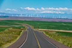 Wind turbines and a paved highway in Eastern Oregon Royalty Free Stock Photography