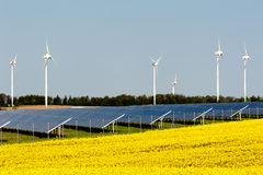 Wind turbines and photovoltaic plant Stock Images