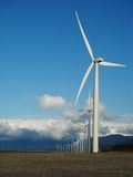 Wind Turbines Portrait. Wind Turbines arranged in an arc Stock Photography