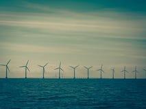 Wind turbines power generator farm along coast sea Royalty Free Stock Photo