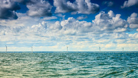 Wind turbines power generator farm along coast sea. Wind turbines power generator farm for renewable energy production along coast baltic sea near Denmark Royalty Free Stock Photo