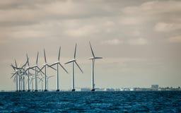 Wind turbines power generator farm along coast sea Royalty Free Stock Photos