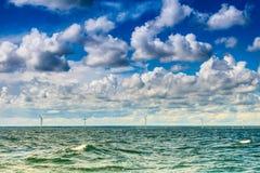 Wind turbines power generator farm along coast sea. Wind turbines power generator farm for renewable energy production along coast baltic sea near Denmark Stock Photography