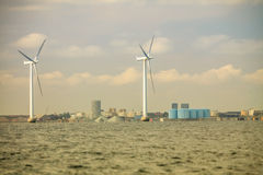 Wind turbines power generator farm along coast sea. Wind turbines power generator farm for renewable energy production along coast baltic sea near Denmark Royalty Free Stock Image
