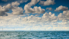 Wind turbines power generator farm along coast sea. Wind turbines power generator farm for renewable energy production along coast baltic sea near Denmark Royalty Free Stock Photos