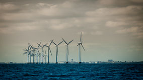 Wind turbines power generator farm along coast sea. Wind turbines power generator farm for renewable energy production along coast baltic sea near Denmark Stock Photos
