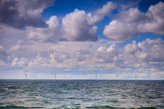 Wind turbines power generator farm along coast sea. Wind turbines power generator farm for renewable energy production along coast baltic sea near Denmark Stock Image