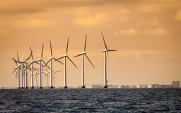 Wind turbines power generator farm along coast sea. Wind turbines power generator farm for renewable energy production along coast baltic sea near Denmark at Royalty Free Stock Image