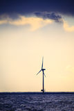 Wind turbines power generator farm along coast sea Stock Image