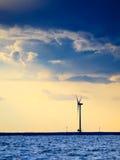 Wind turbines power generator farm along coast sea Royalty Free Stock Image