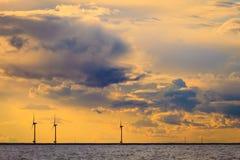 Wind turbines power generator farm along coast sea. Wind turbines power generator farm for renewable energy production along coast baltic sea near Denmark at Stock Photo