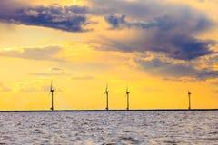 Wind turbines power generator farm along coast sea. Wind turbines power generator farm for renewable energy production along coast baltic sea near Denmark at Royalty Free Stock Images