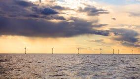 Wind turbines power generator farm along coast sea. Wind turbines power generator farm for renewable energy production along coast baltic sea near Denmark at Royalty Free Stock Photography