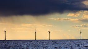 Wind turbines power generator farm along coast sea. Wind turbines power generator farm for renewable energy production along coast baltic sea near Denmark at Stock Image