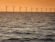 Wind turbines power generator farm along coast sea Royalty Free Stock Photo