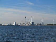 Wind turbines power generator farm in sea. Wind turbines power generator farm for renewable energy production along coast baltic sea near Denmark. Alternative Royalty Free Stock Images