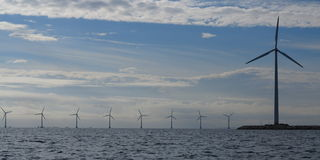 Wind turbines power generator farm in sea. Wind turbines power generator farm for renewable energy production along coast baltic sea near Denmark. Alternative Royalty Free Stock Photography