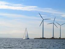 Wind turbines power generator farm in sea. Wind turbines power generator farm for renewable energy production along coast baltic sea near Denmark. Alternative Royalty Free Stock Photos