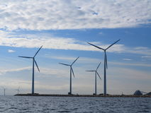 Wind turbines power generator farm in sea Stock Photo