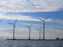 Wind turbines power generator farm in sea. Wind turbines power generator farm for renewable energy production along coast baltic sea near Denmark. Alternative Stock Photo