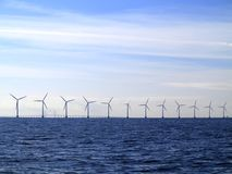 Wind turbines power generator farm in sea. Wind turbines power generator farm for renewable energy production along coast baltic sea near Denmark. Alternative Stock Photography