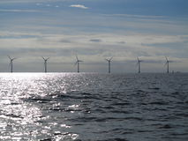 Wind turbines power generator farm in sea Stock Photography