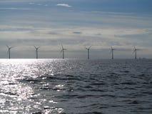 Wind turbines power generator farm in sea. Wind turbines power generator farm for renewable energy production along coast baltic sea near Denmark. Alternative Stock Photography