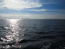 Wind turbines power generator farm in sea. Wind turbines power generator farm for renewable energy production along coast baltic sea near Denmark. Alternative Royalty Free Stock Image