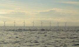Wind turbines power generator farm in sea. Wind turbines power generator farm for renewable energy production along coast baltic sea near Denmark. Alternative Stock Image