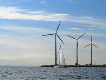 Wind turbines power generator farm in sea Stock Images
