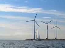 Wind turbines power generator farm in sea. Wind turbines power generator farm for renewable energy production along coast baltic sea near Denmark. Alternative Stock Images