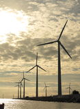 Wind turbines power generator farm in sea Royalty Free Stock Images
