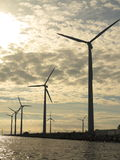 Wind turbines power generator farm in sea Stock Photos