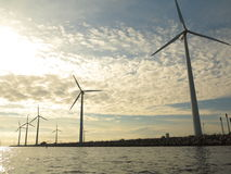 Wind turbines power generator farm in sea Royalty Free Stock Photos