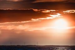Wind turbines power generator farm in sea. Wind turbines power generator farm for renewable energy production along coast baltic sea near denmark. Aternative Stock Image
