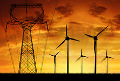 Wind turbines with power line. In the sunset Royalty Free Stock Photography