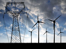Wind turbines with power line. In the sunset Royalty Free Stock Image