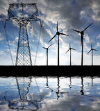 Wind turbines with power line. In the sunset Stock Photos