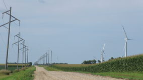 Wind Turbines and Power Lines stock video footage