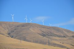 Wind Turbines and Power Lines on Desert Ridge. These are wind turbines that generate electricity on a desert ridge on the Washington side of the Columbia River royalty free stock images
